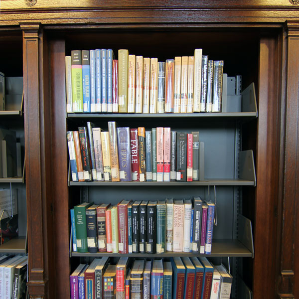 cantilever shelving in wooden book cases