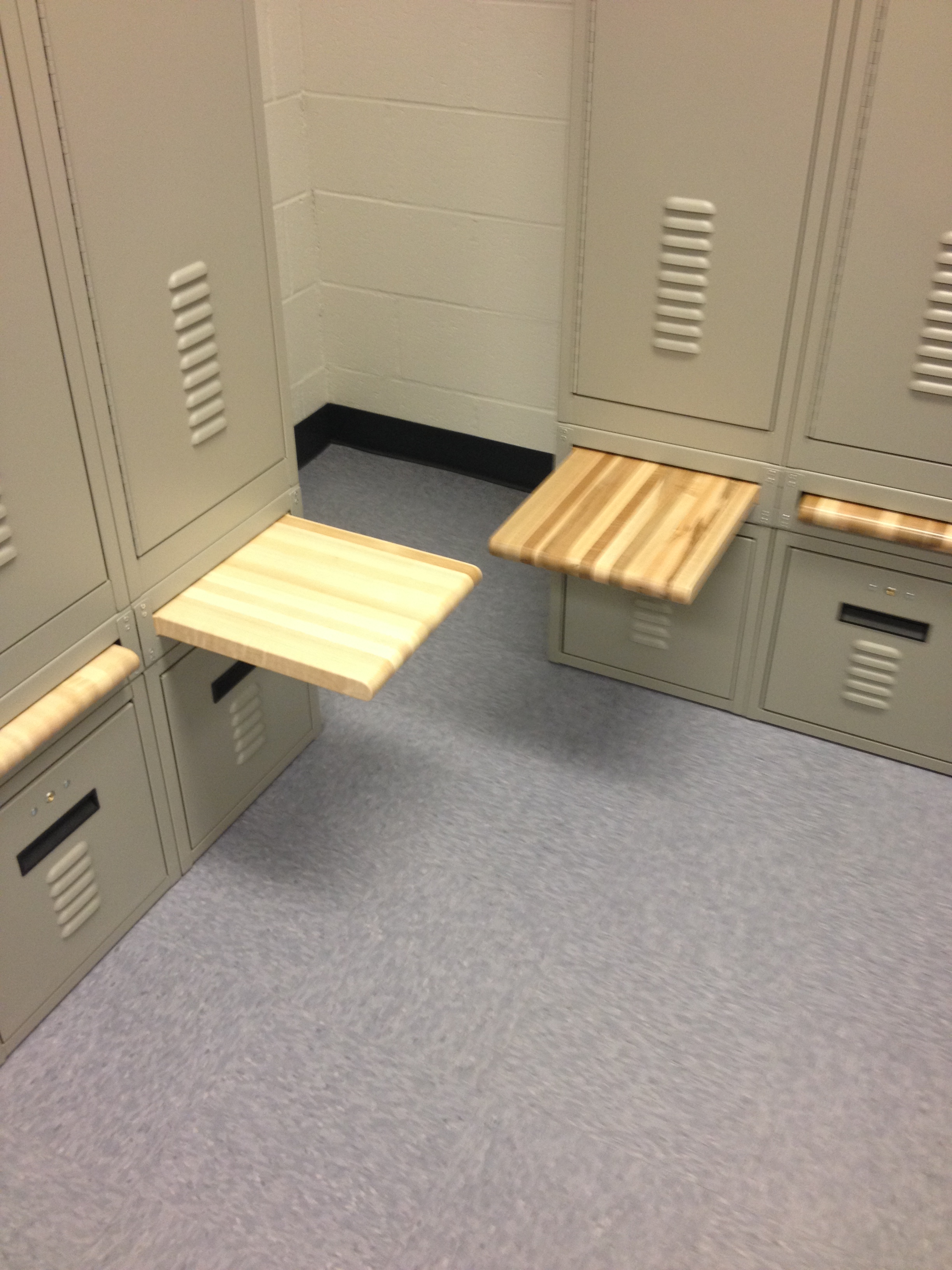 Lockers with retractable bench seating