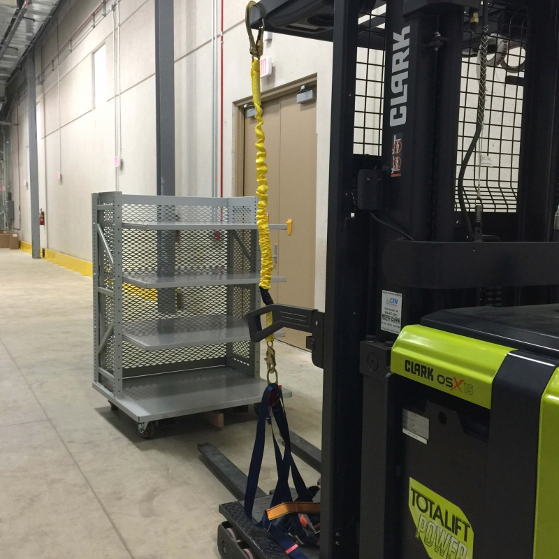 forklift and wheeled caddy spacesaver shelving