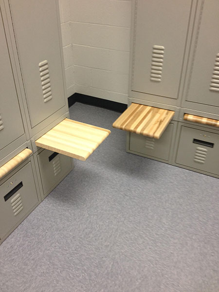 Retractable wood bench in guard locker room at East Mesa Reentry Facility