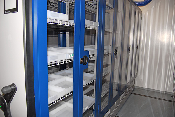 Mechanical Assist mobile storage system with trays on wire shelving for Pharma Compound Chemical Storage