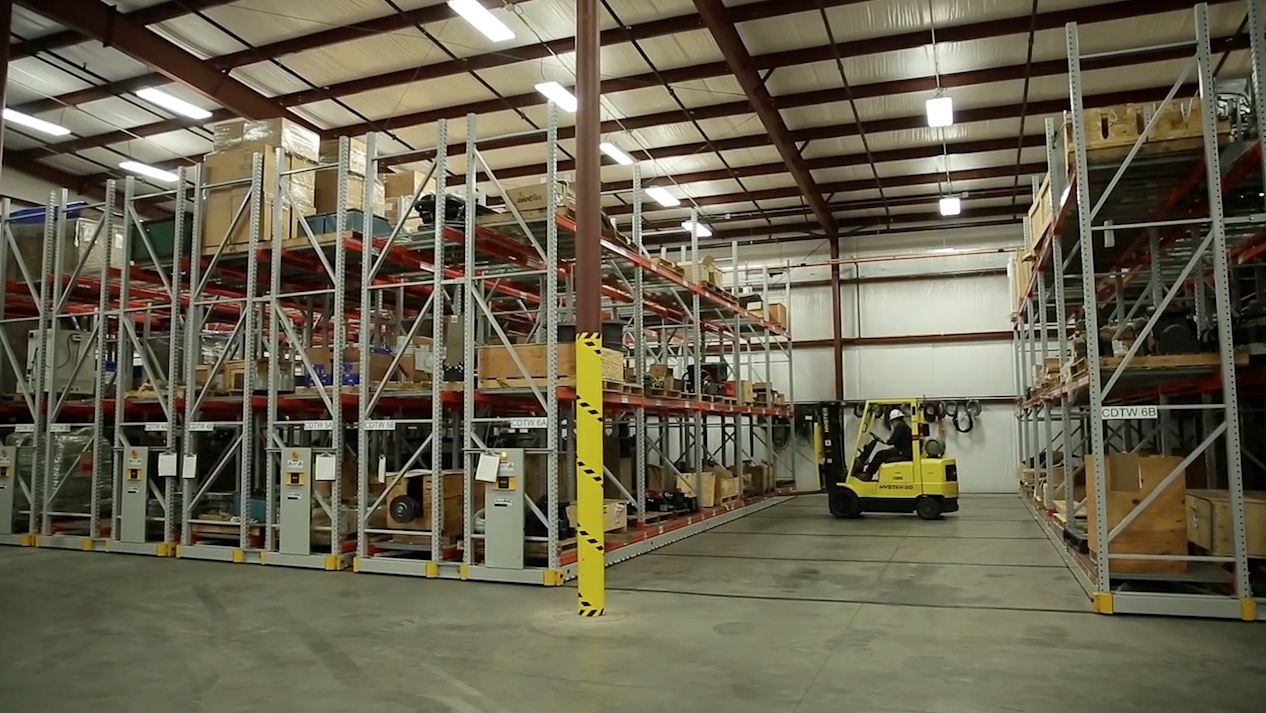 Forklift in Mobile Racking with Turbine Part Storage