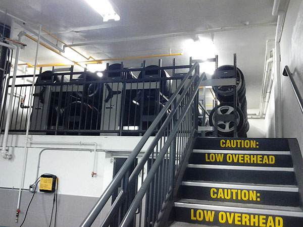 Tire storage system in Porsche auto dealership on compact mobile racking