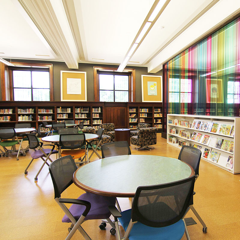 Compact shelving in library teen space and childrens reading area