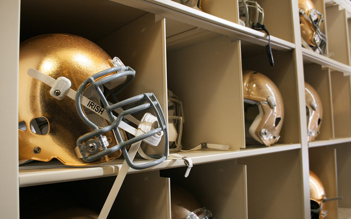 Notre Dame Fighting Irish football equipment on Spacesaver 4-Post Shelving