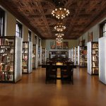 Cantilever Library Shelving with illuminated shelving and custom end panels, St. Louis Central Library