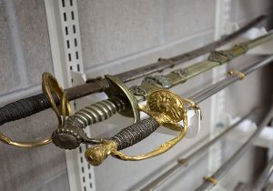museum sword saber storage collection shelving