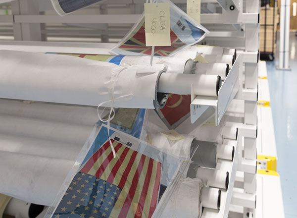 preserving historic flags on rolled textile racks