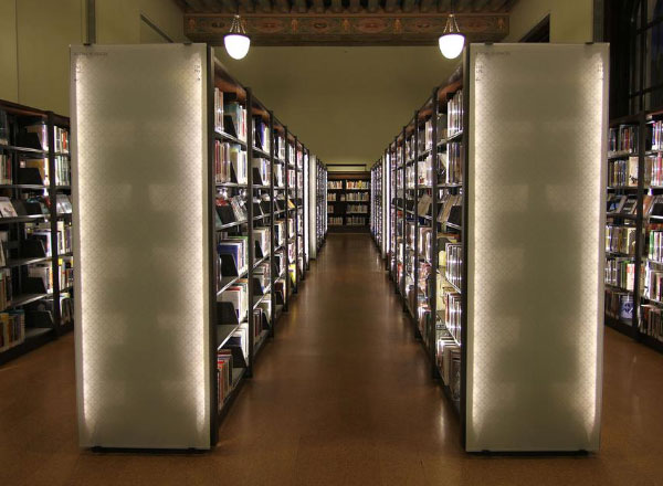 lighting integrated into book shelving