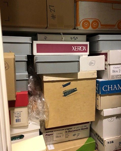 before Spacesaver Systems - packed unorganized closet