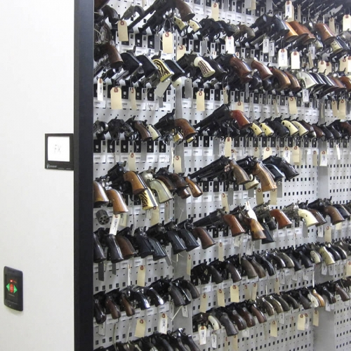 Pistols stored on mobile weapon rack at Illinois Metro East Forensic Science Lab