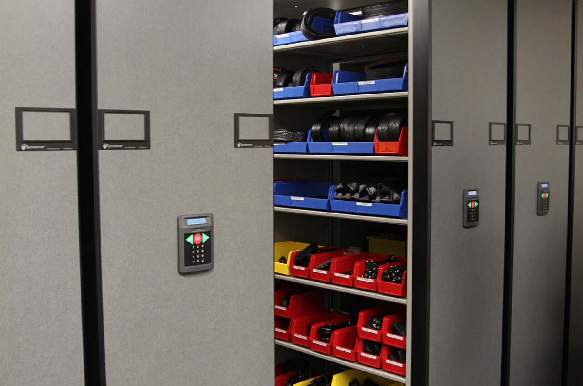 Beau Duty Belts And Holster Storage In Bins On Mobile Shelving At Aurora Police  Dept.