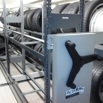 Compact mobile storage for tires at Porsche auto dealership
