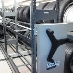 Compact mobile storage racking for tires at Porsche auto dealership