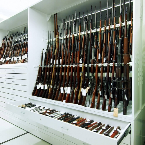 Historic weapons racked on mobile shelving