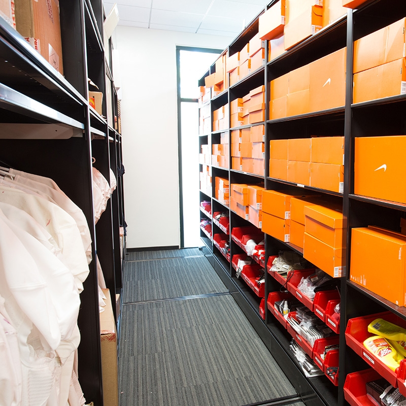 Compact mobile shelving storage for football team uniforms and shoes